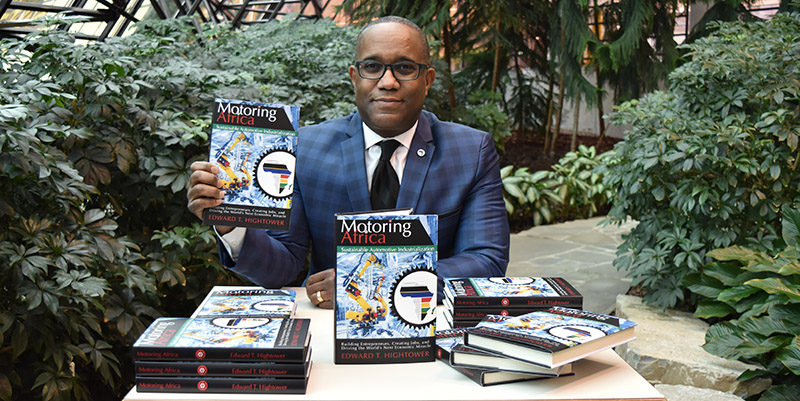 Edward Hightower with book Motoring Africa