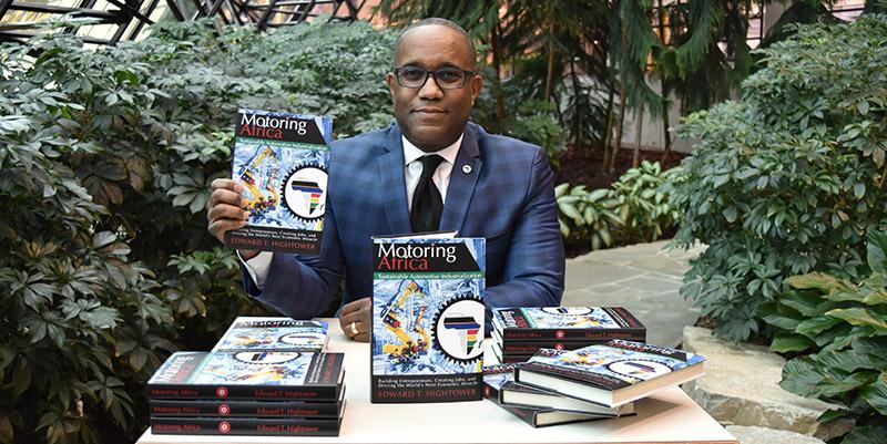 Edward Hightower with book Motoring Africa